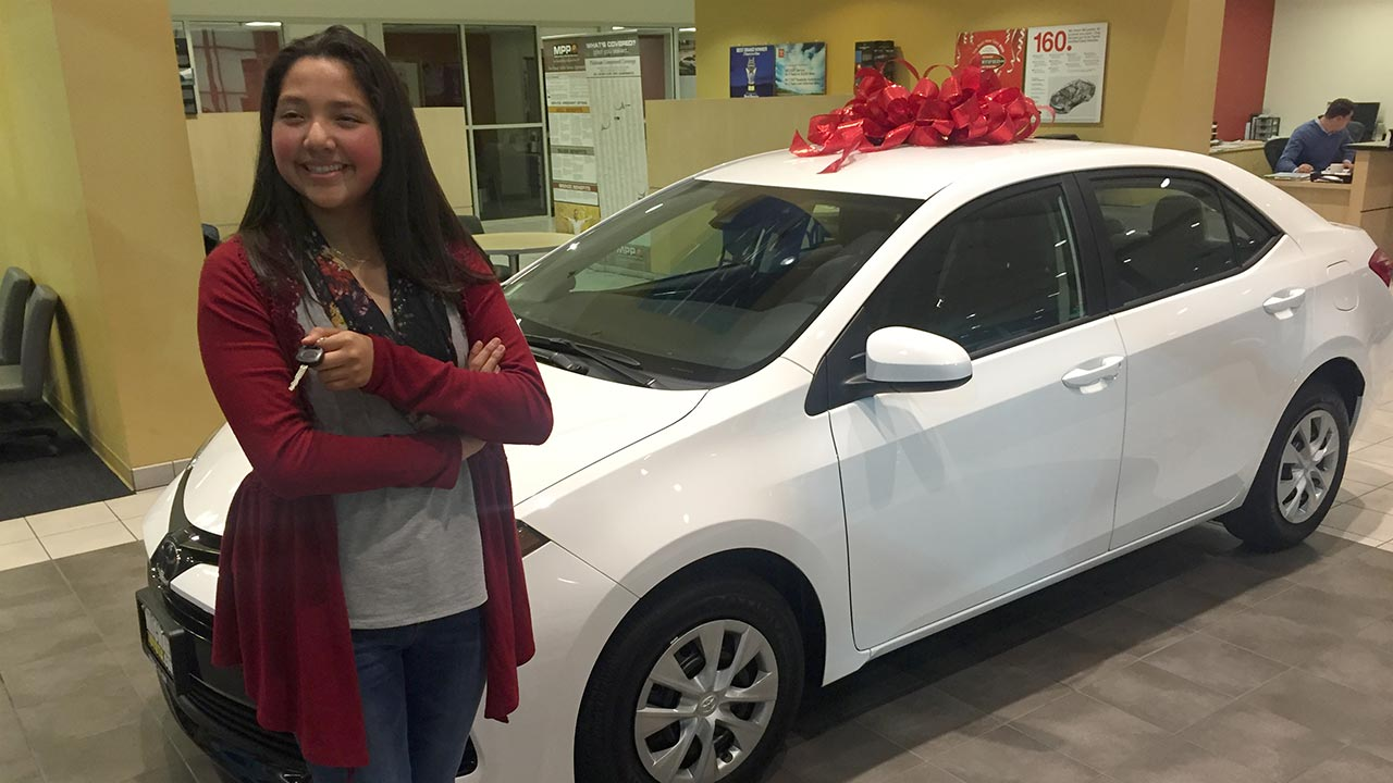 Michelle Salazar poses with her new car