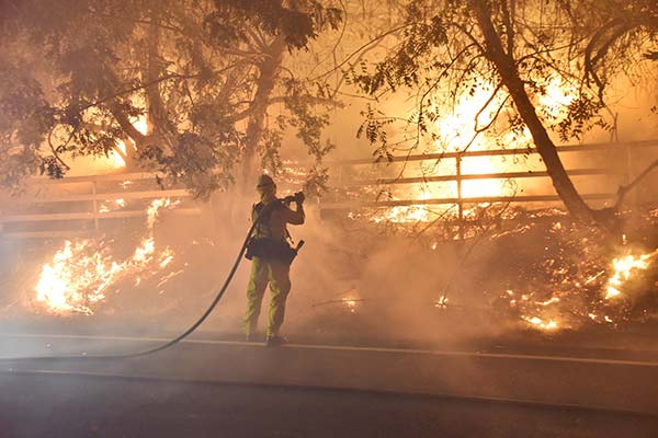"<div class=""meta image-caption""><div class=""origin-logo origin-image ap""><span>AP</span></div><span class=""caption-text"">In this photo provided by the Ventura County Fire Department, a firefighter works to put out a blaze early Tuesday, Dec. 5, 2017, in Santa Paula, California. (Ryan Cullom/Ventura County Fire Department via AP)</span></div>"