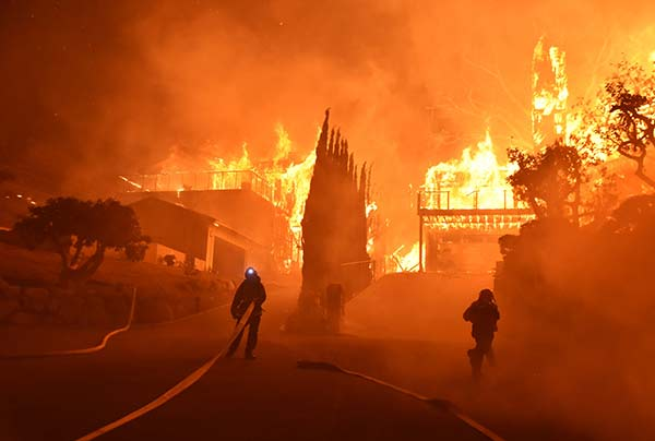 "<div class=""meta image-caption""><div class=""origin-logo origin-image ap""><span>AP</span></div><span class=""caption-text"">In this photo provided by the Ventura County Fire Department, firefighters work to put out a blaze burning homes early Tuesday, Dec. 5, 2017, in Ventura, California. (Ryan Cullom/Ventura County Fire Department via AP)</span></div>"