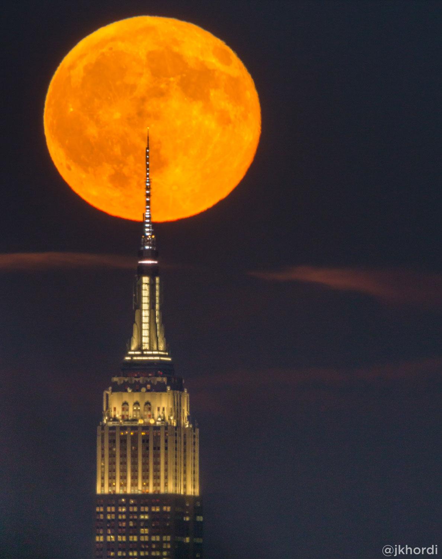 <div class='meta'><div class='origin-logo' data-origin='none'></div><span class='caption-text' data-credit='Jennier Khordi (@jkhordi)'>The moon behind the Empire State Building</span></div>