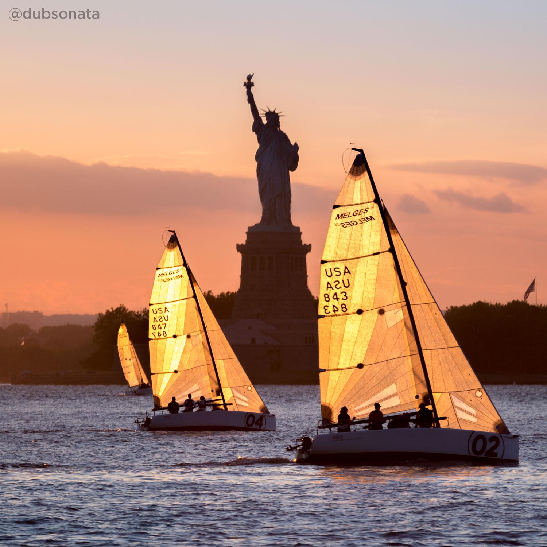 <div class='meta'><div class='origin-logo' data-origin='none'></div><span class='caption-text' data-credit='Christopher Markisz (@dubsonata)'>The Statue of Liberty behind sailboats</span></div>