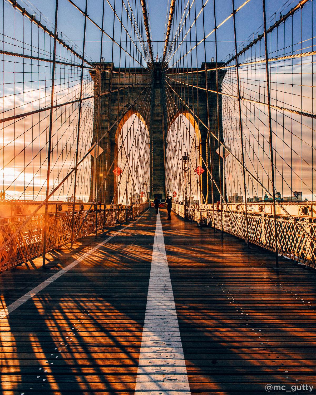 <div class='meta'><div class='origin-logo' data-origin='none'></div><span class='caption-text' data-credit='Mike Gutkin (@mc_gutty)'>Sunrise on the Brooklyn Bridge</span></div>