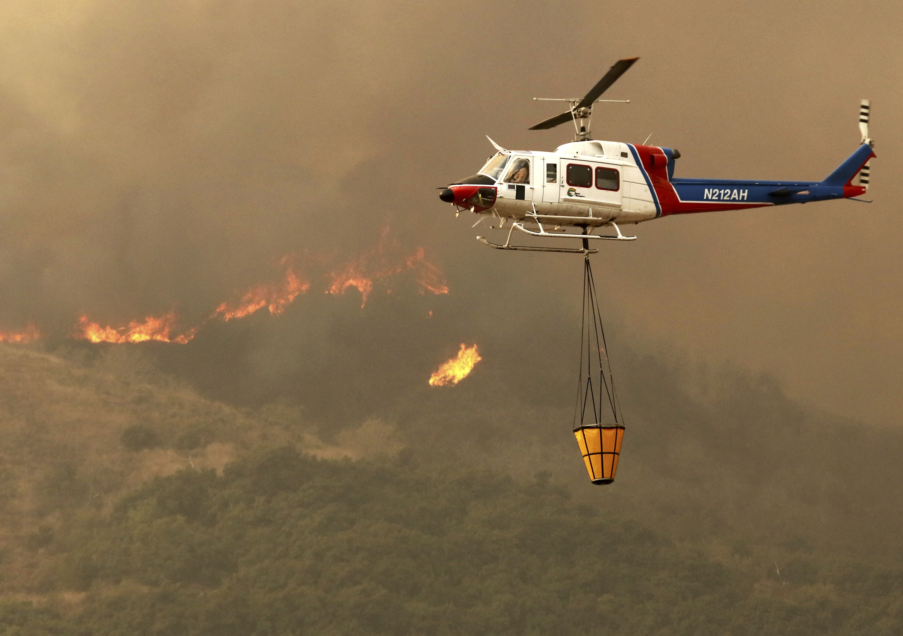 "<div class=""meta image-caption""><div class=""origin-logo origin-image none""><span>none</span></div><span class=""caption-text"">A helicopter makes a water drop on hot spots after the Thomas fire swept through Ventura, Calif., Tuesday, Dec. 5, 2017. (Daniel Dreifuss via AP)</span></div>"