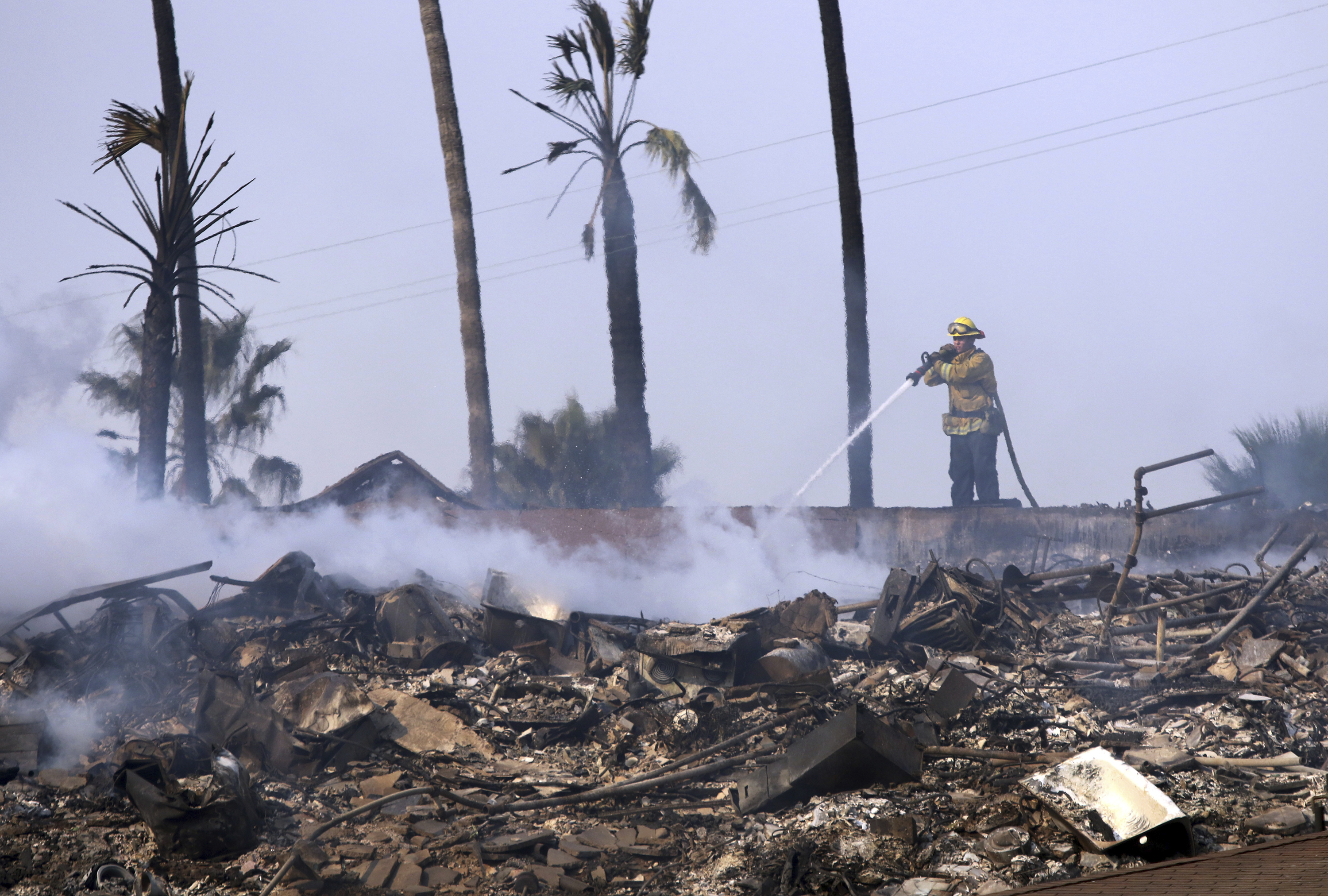 "<div class=""meta image-caption""><div class=""origin-logo origin-image none""><span>none</span></div><span class=""caption-text"">A firefighter hoses down the remains of a destroyed home after the Thomas fire swept through Ventura, Calif., Tuesday, Dec. 5, 2017. (Daniel Dreifuss via AP)</span></div>"