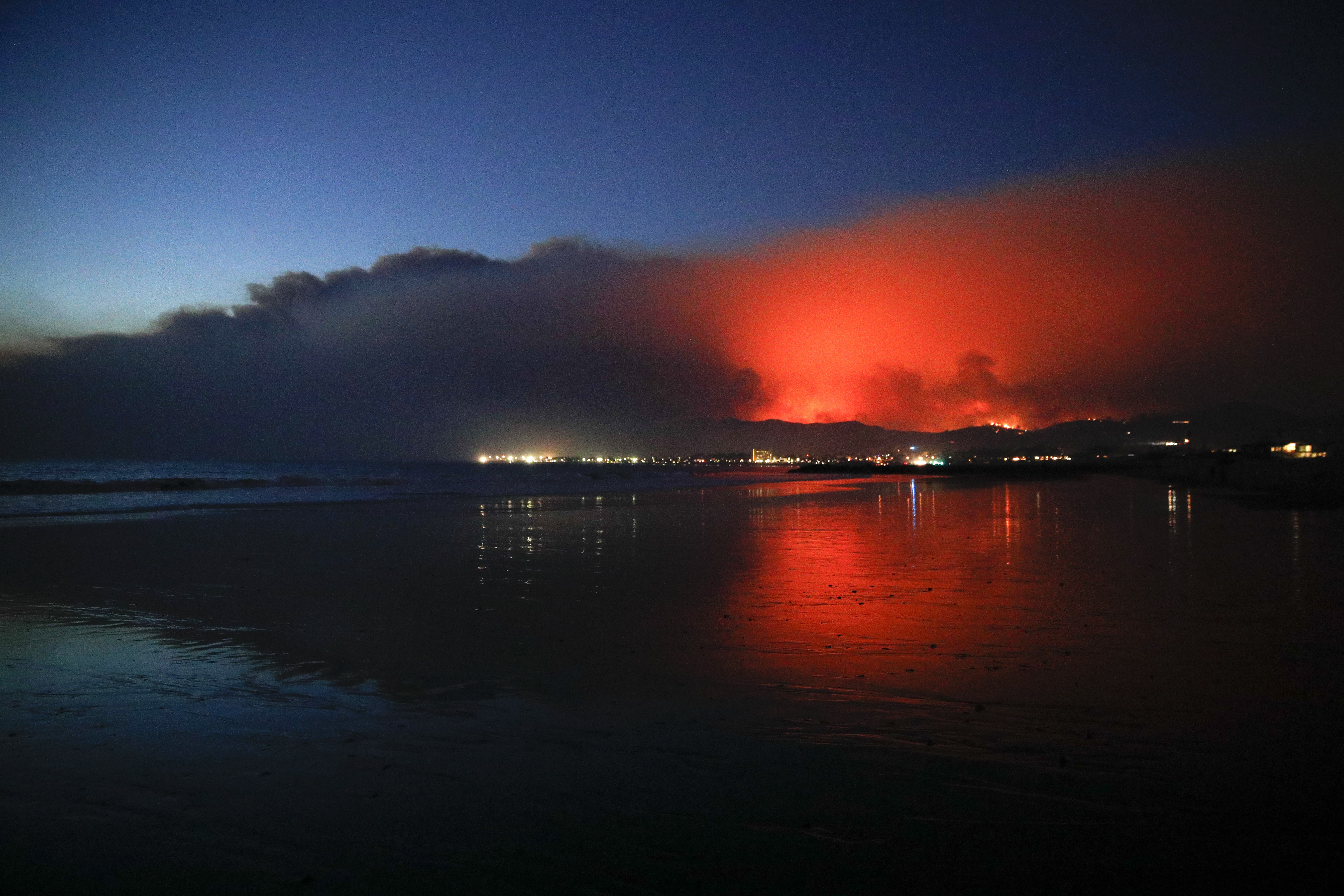 <div class='meta'><div class='origin-logo' data-origin='none'></div><span class='caption-text' data-credit='Jae C. Hong/AP Photo'>A wildfire continues to burn as its red glow is reflected on the beach Tuesday, Dec. 5, 2017, in Ventura, Calif.</span></div>
