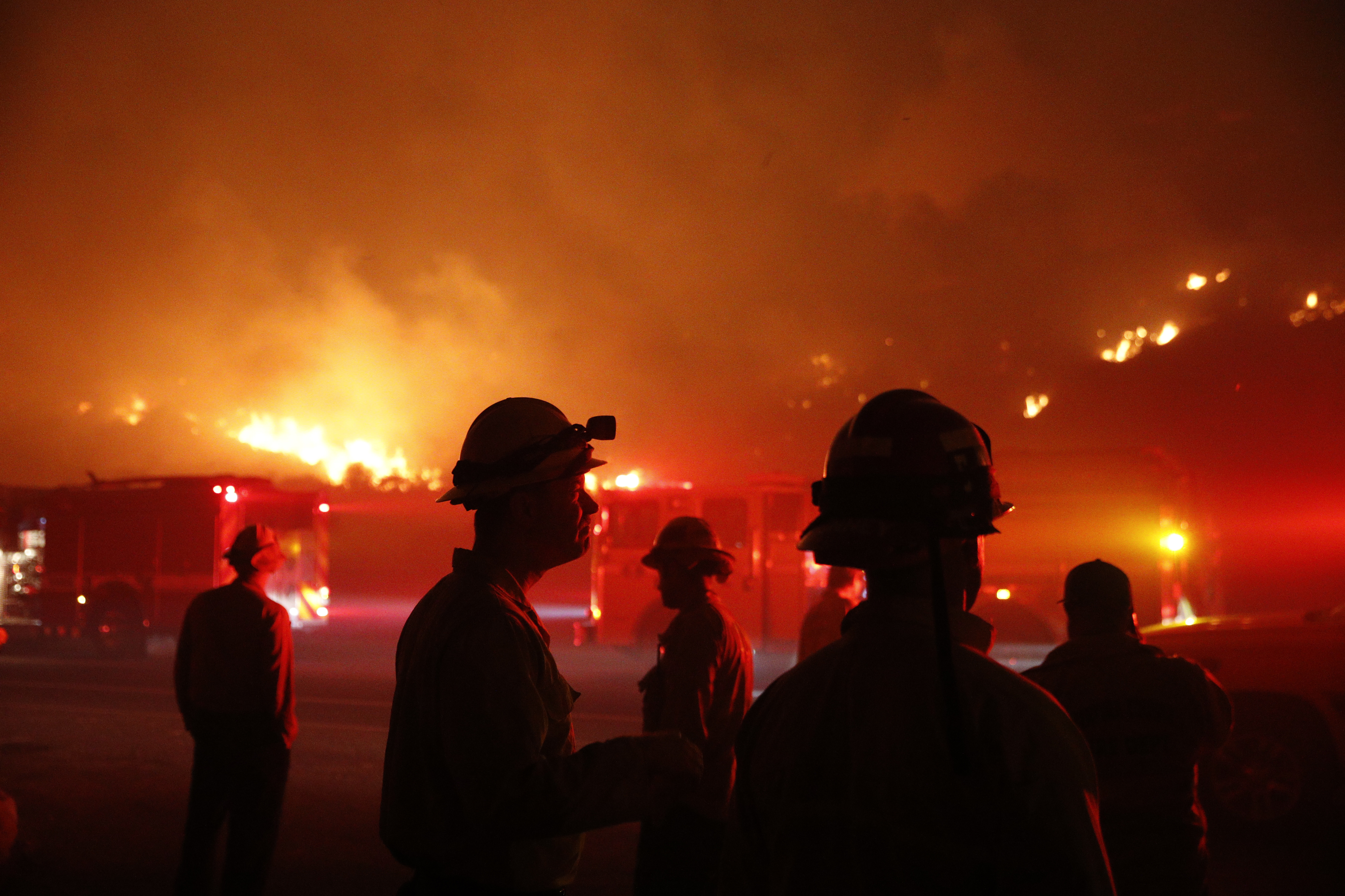 <div class='meta'><div class='origin-logo' data-origin='none'></div><span class='caption-text' data-credit='Jae C. Hong/AP Photo'>Firefighters gather in front of a residential area as a wildfire burns along the 101 Freeway Tuesday, Dec. 5, 2017, in Ventura, Calif.</span></div>