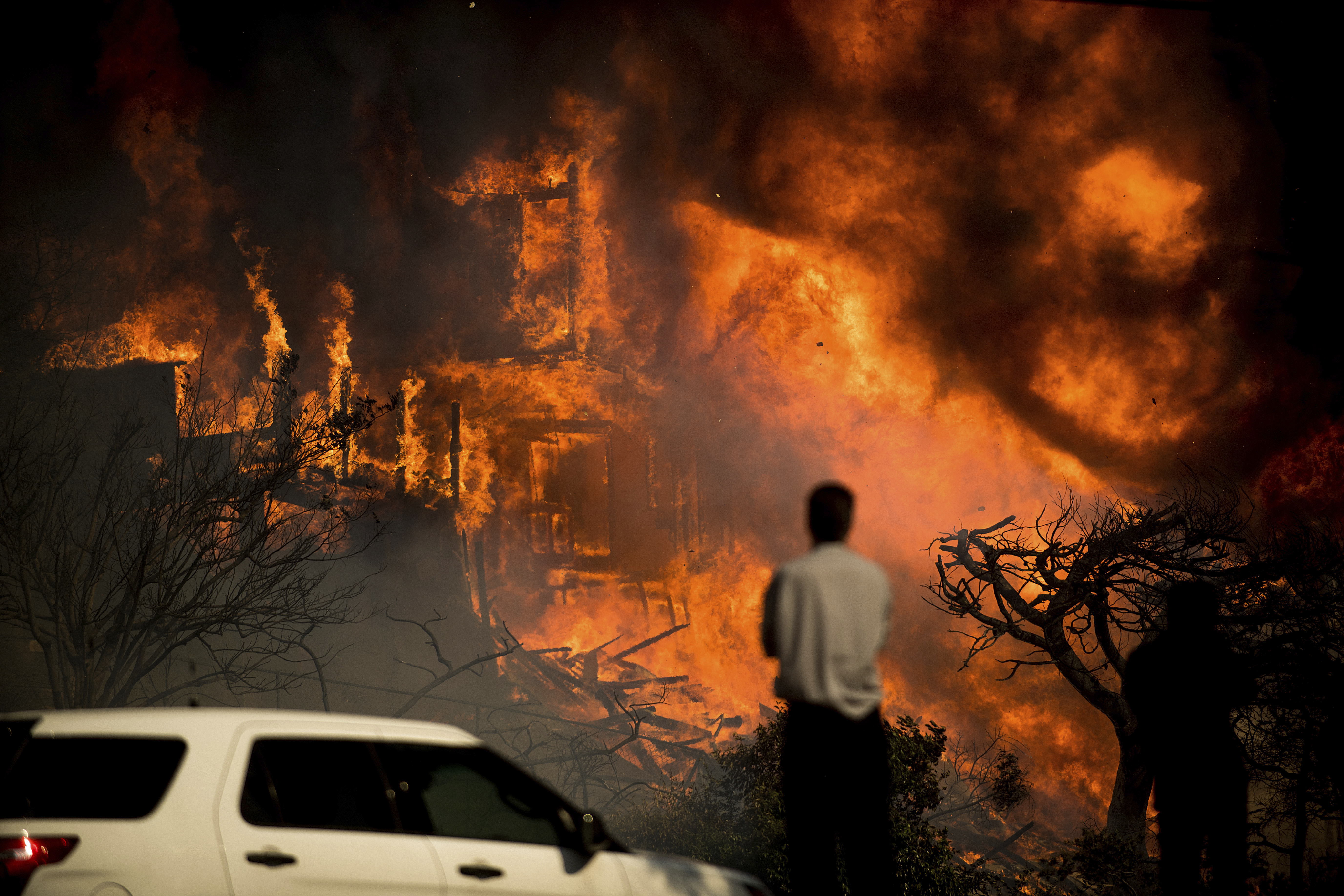 <div class='meta'><div class='origin-logo' data-origin='none'></div><span class='caption-text' data-credit='Noah Berger/AP Photo'>A man watches flames consume a residence as a wildfire rages in Ventura, Calif., Tuesday, Dec. 5, 2017.</span></div>