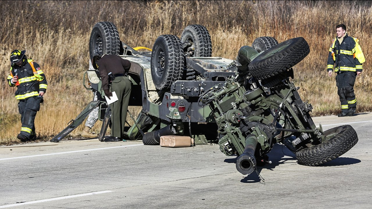 National Guard Humvee rolls over on I-80