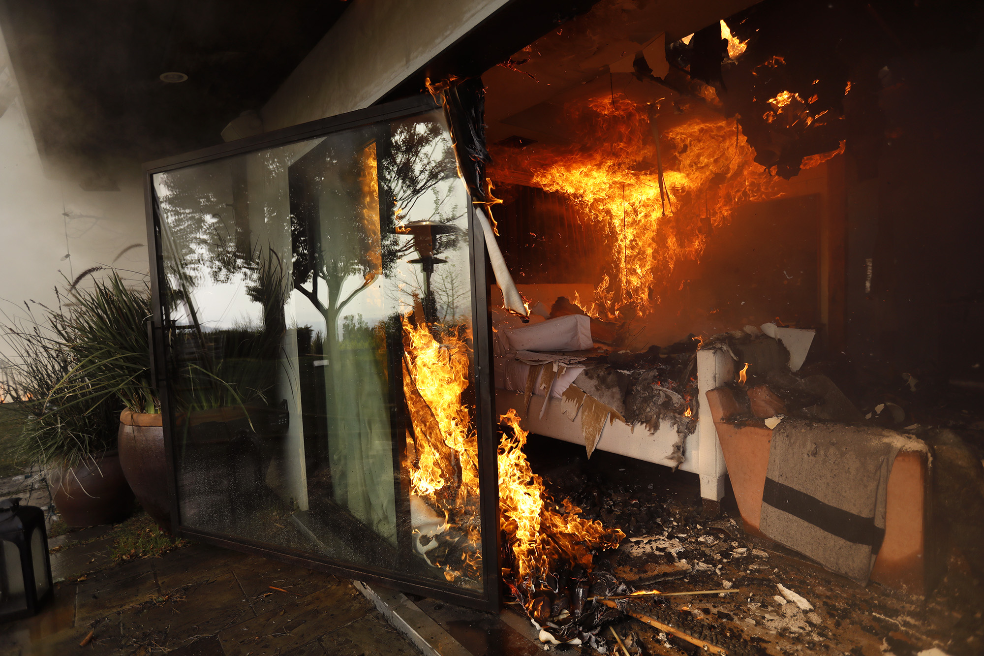 <div class='meta'><div class='origin-logo' data-origin='none'></div><span class='caption-text' data-credit='Genaro Molina / Los Angeles Times via Getty Images'>The bedroom of a home is engulfed in flames from the Skirball fire along Linda Flora Drive on December 6, 2017 in Bel-Air, California.</span></div>