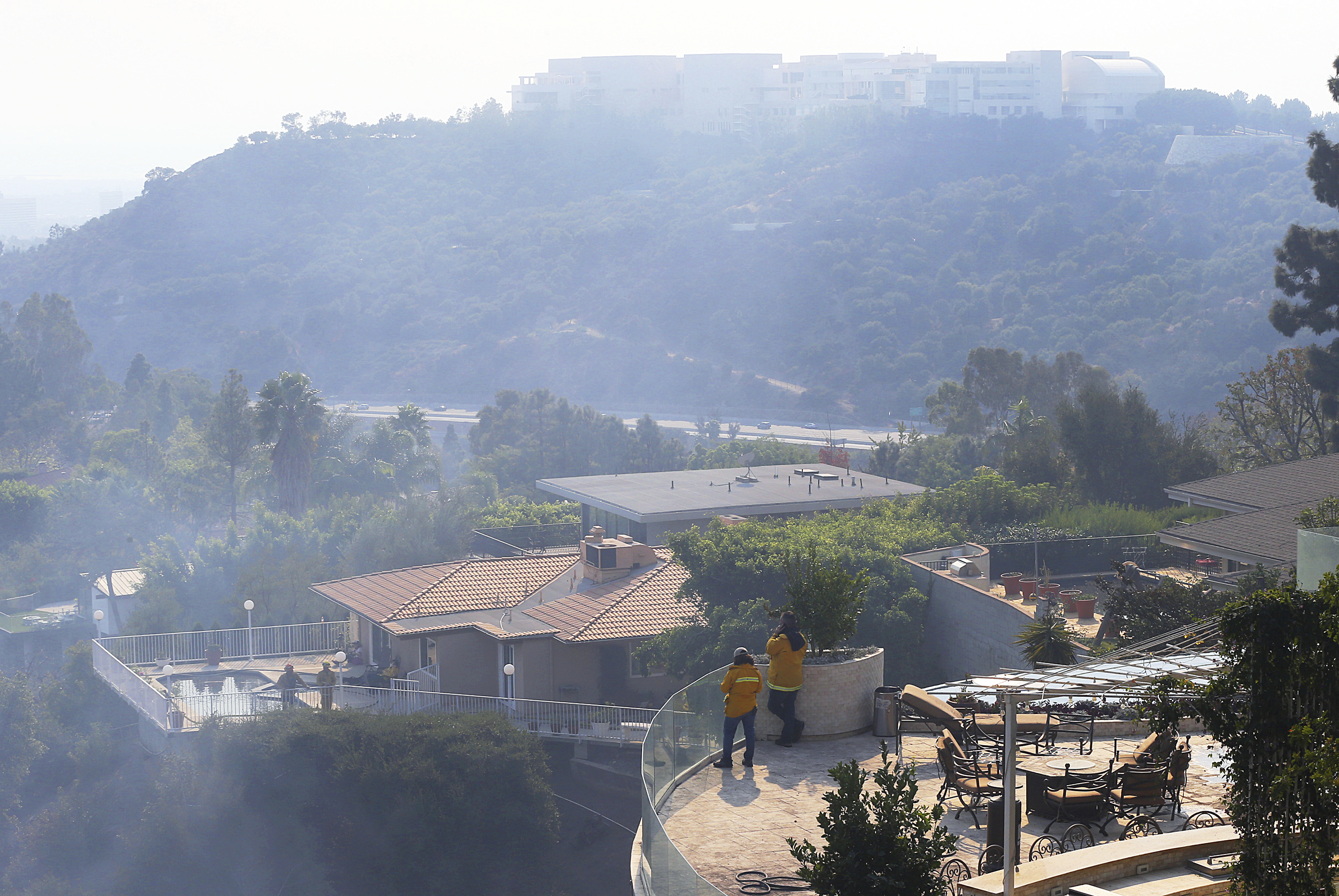 "<div class=""meta image-caption""><div class=""origin-logo origin-image none""><span>none</span></div><span class=""caption-text"">The Getty Center lies shrouded in smoke as firefighters keep watch on a nearby canyon from the terraces of homes in the Bel Air district on Wednesday, Dec. 6, 2017. (Reed Saxon/AP Photo)</span></div>"