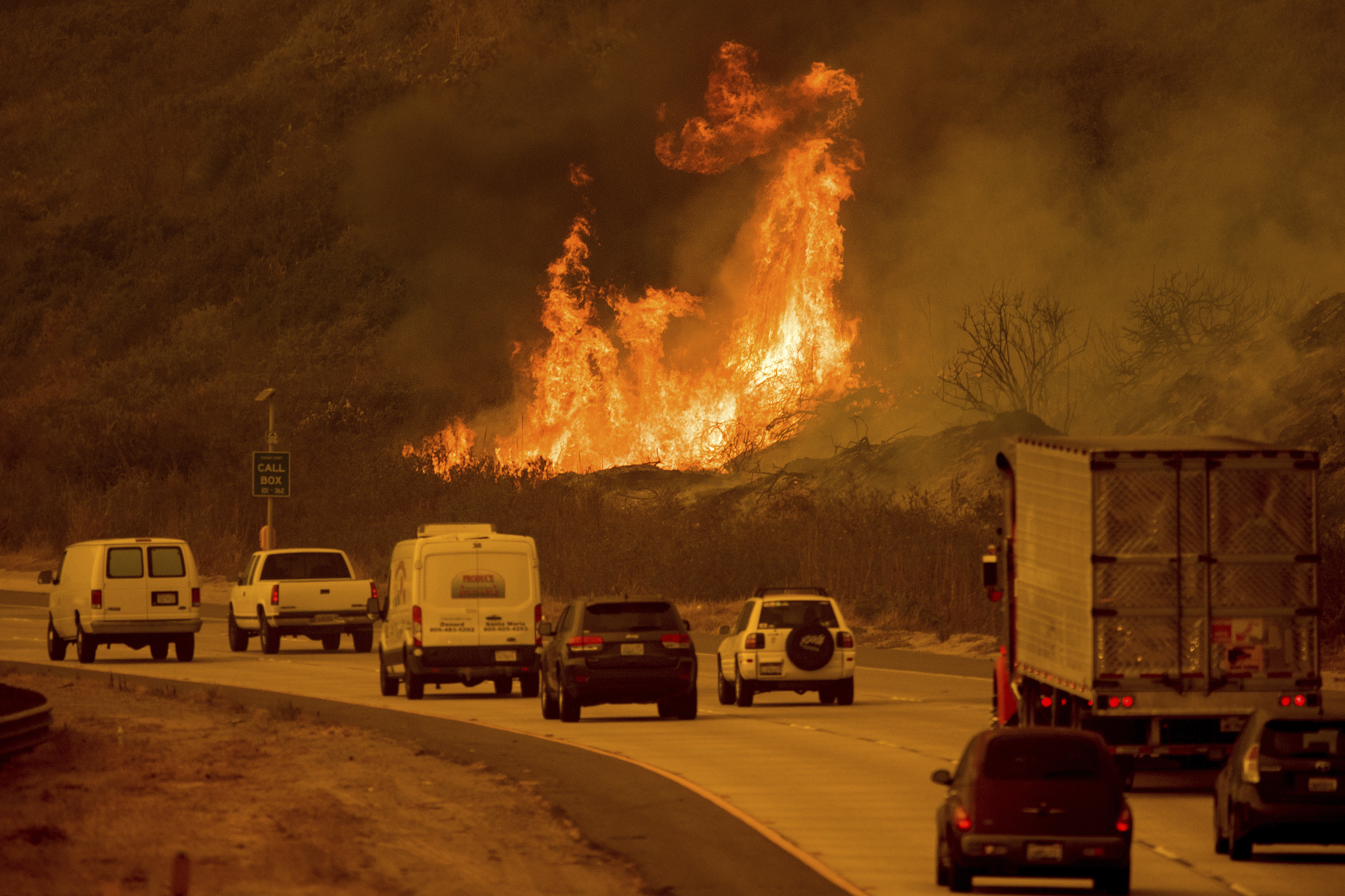 <div class='meta'><div class='origin-logo' data-origin='none'></div><span class='caption-text' data-credit='Noah Berger/AP Photo'>Flames from a wildfire leap above traffic on Highway 101 north of Ventura, Calif., on Wednesday, Dec. 6, 2017.</span></div>