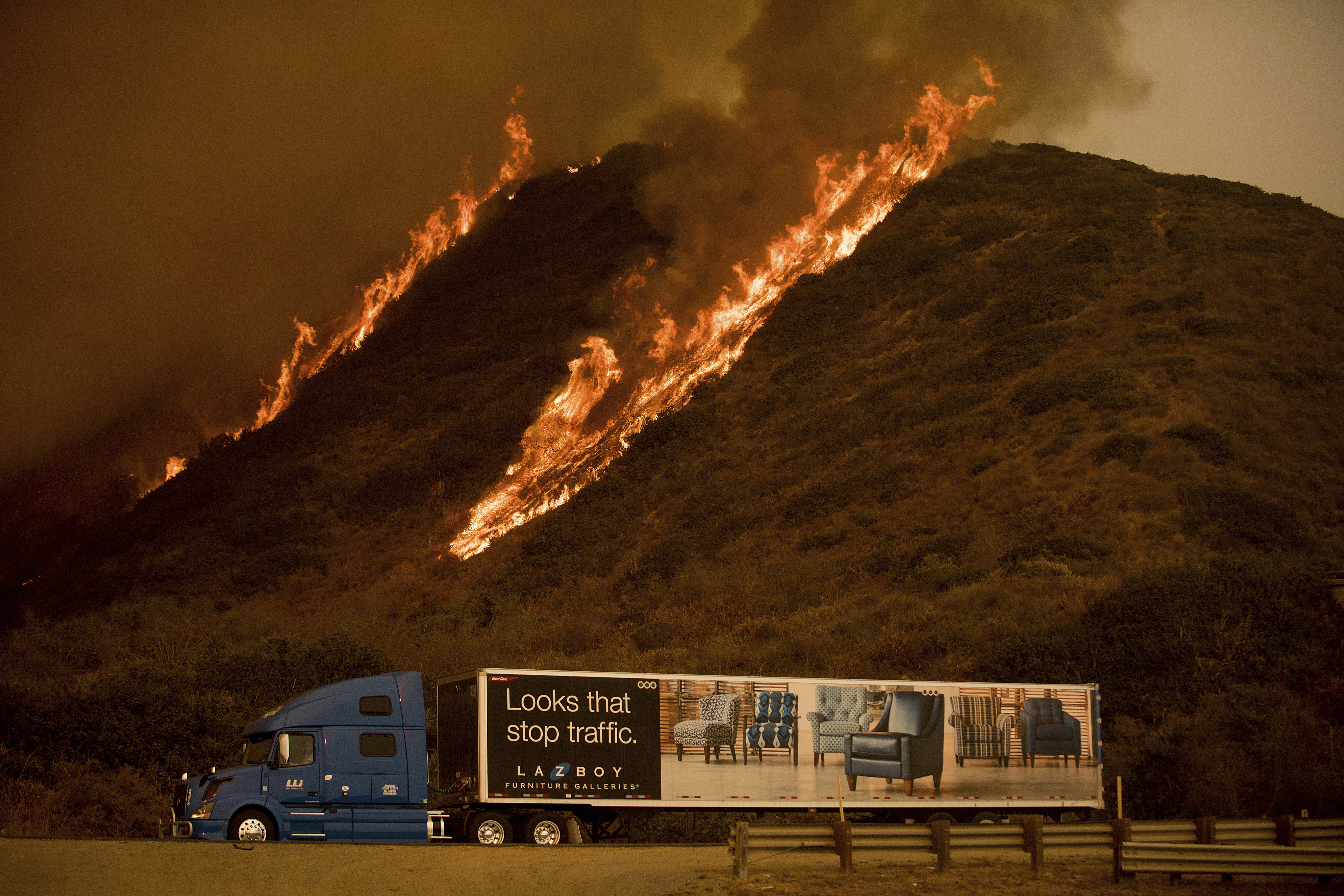 <div class='meta'><div class='origin-logo' data-origin='none'></div><span class='caption-text' data-credit='Noah Berger/AP Photo'>Flames from the Thomas fire burn above a truck on Highway 101 north of Ventura, Calif., on Wednesday, Dec. 6, 2017.</span></div>