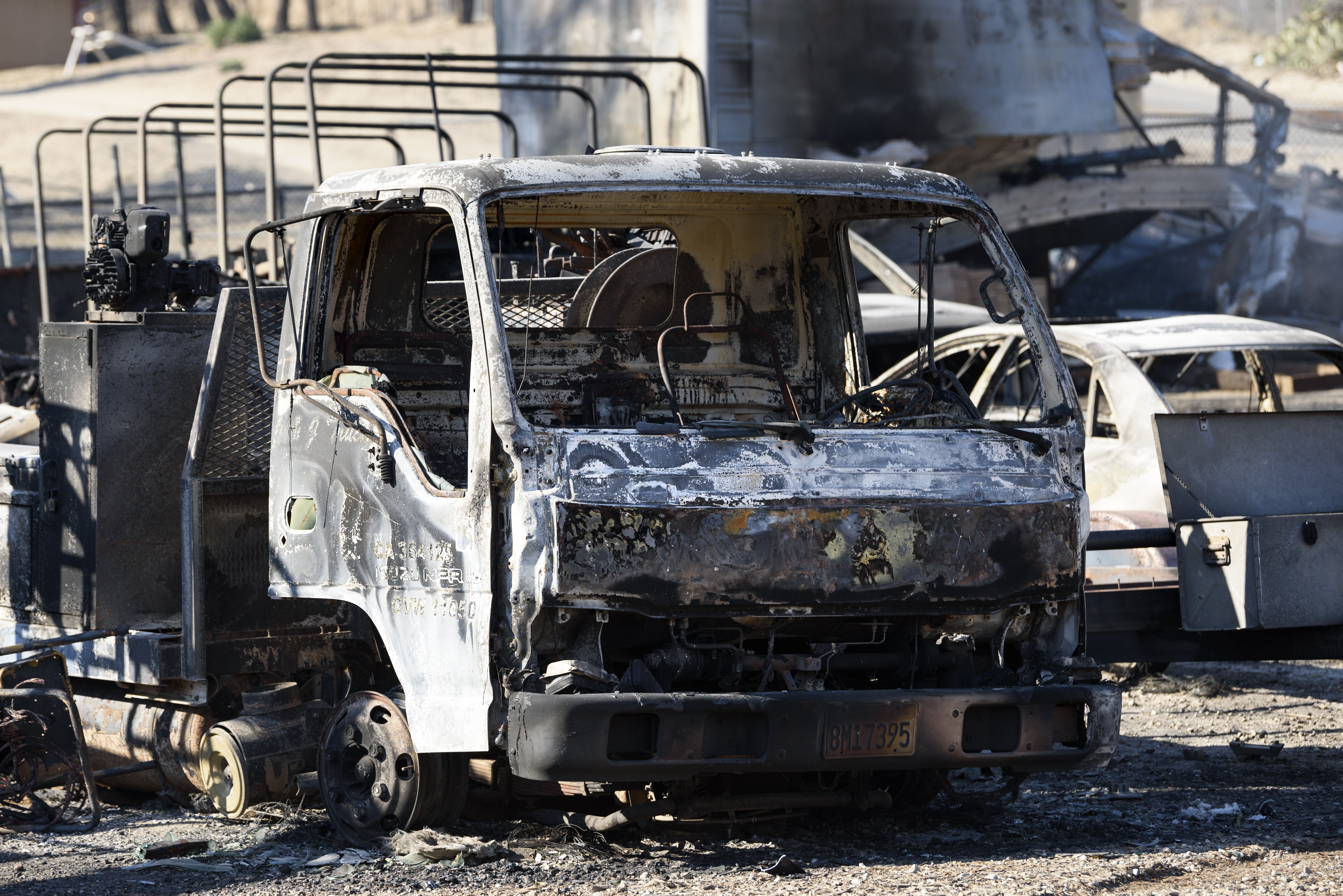 <div class='meta'><div class='origin-logo' data-origin='none'></div><span class='caption-text' data-credit='Ronen Tivony/NurPhoto via Getty'>A truck destroyed by the Creek Fire in the Sylmar neighborhood in Los Angeles, California, on December 6, 2017.</span></div>