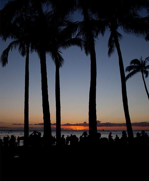 "<div class=""meta image-caption""><div class=""origin-logo origin-image ""><span></span></div><span class=""caption-text"">The sun set on New Year's Eve on Waikiki Beach. (Carolyn Kaster / AP)</span></div>"