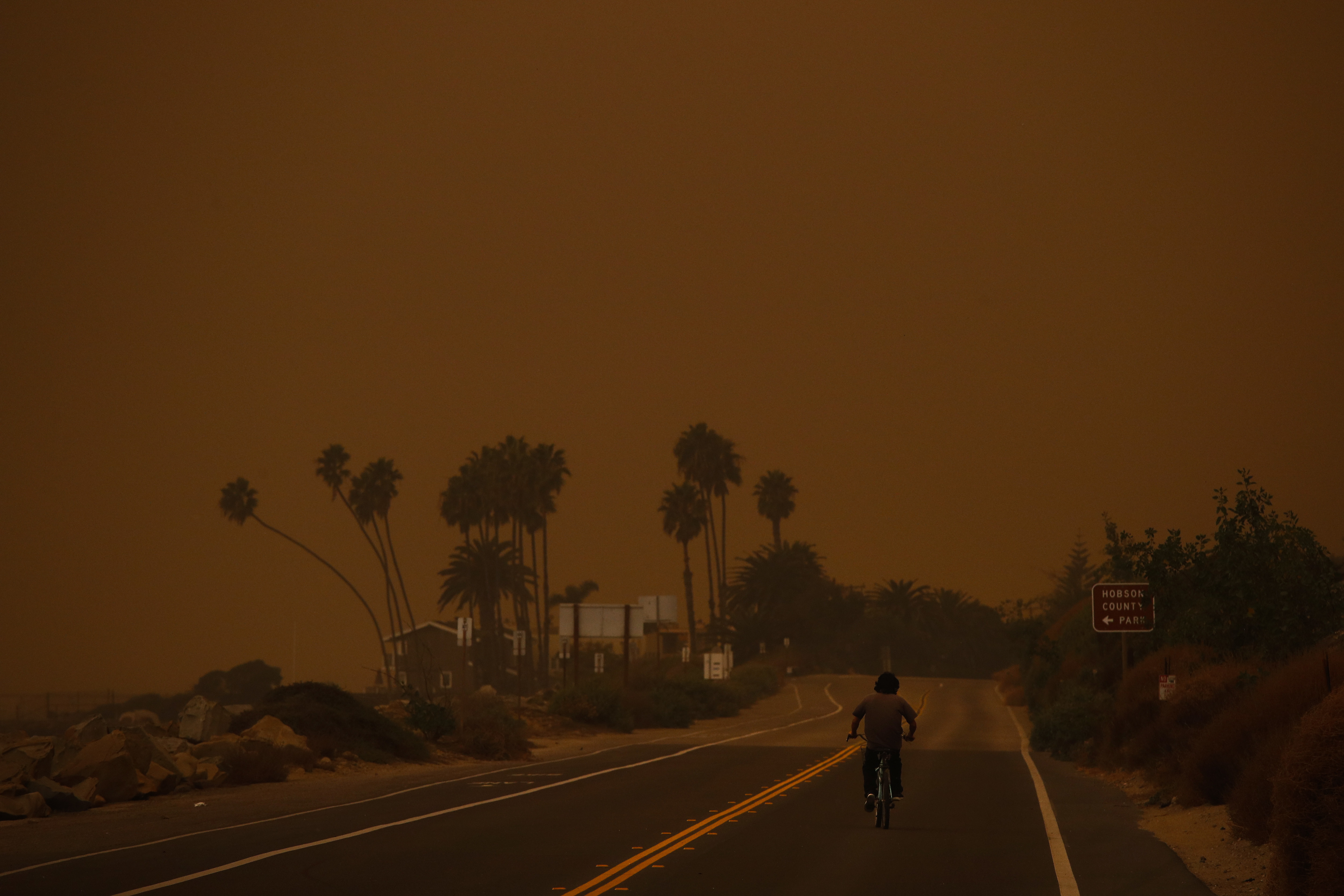 <div class='meta'><div class='origin-logo' data-origin='none'></div><span class='caption-text' data-credit='Jae C. Hong/AP Photo'>A man rides his bicycle along the Pacific Coast Highway as thick smoke from a massive wildfire fills the air at Faria State Beach in Ventura, Calif., Thursday, Dec. 7, 2017.</span></div>