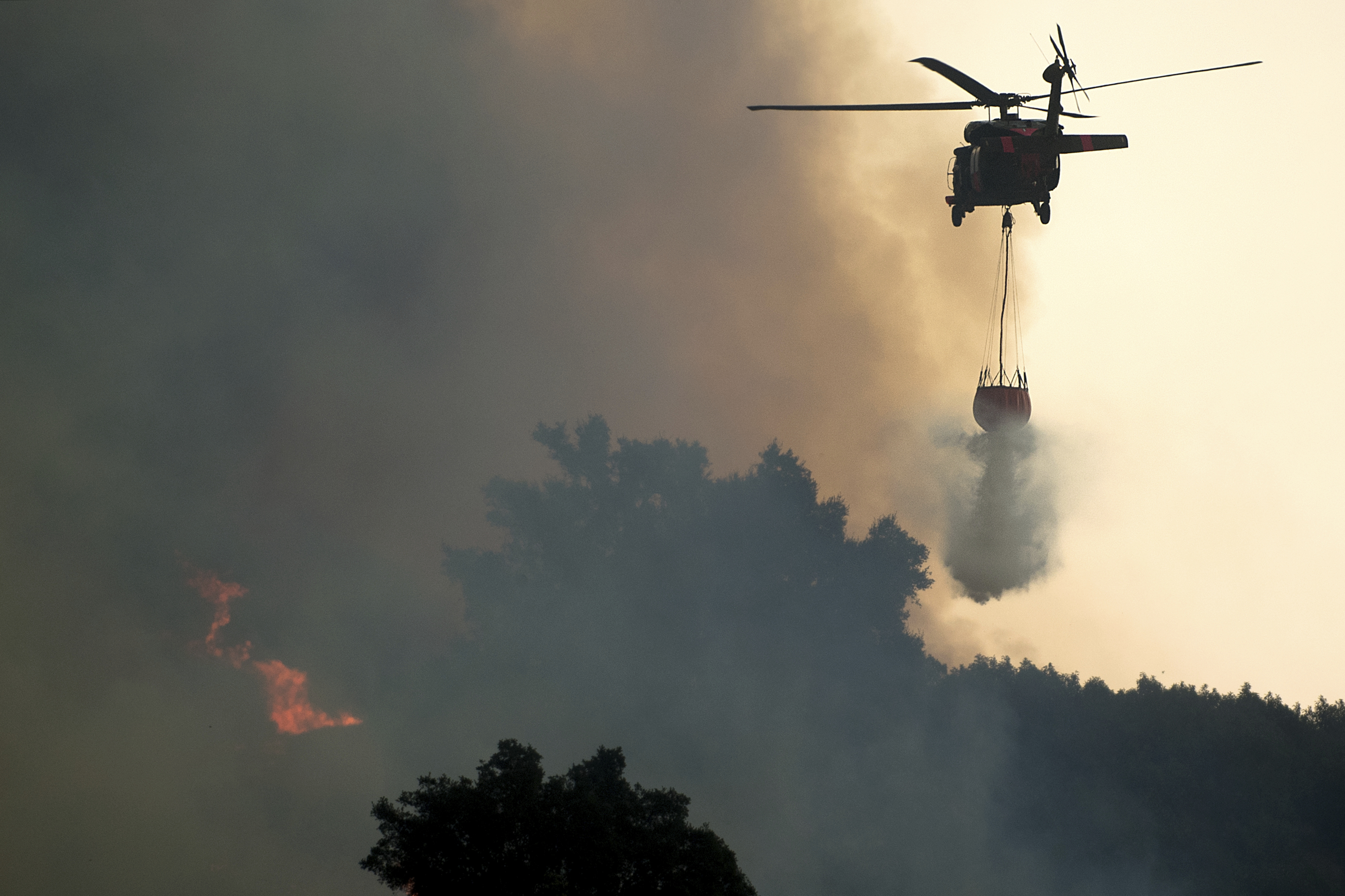 <div class='meta'><div class='origin-logo' data-origin='none'></div><span class='caption-text' data-credit='Noah Berger/AP Photo'>A helicopter drops water while battling the Thomas fire in Ojai, Calif., on Dec. 7.  Ojai, a scenic mountain town, is known for its boutique hotels and New Age spiritual retreats.</span></div>