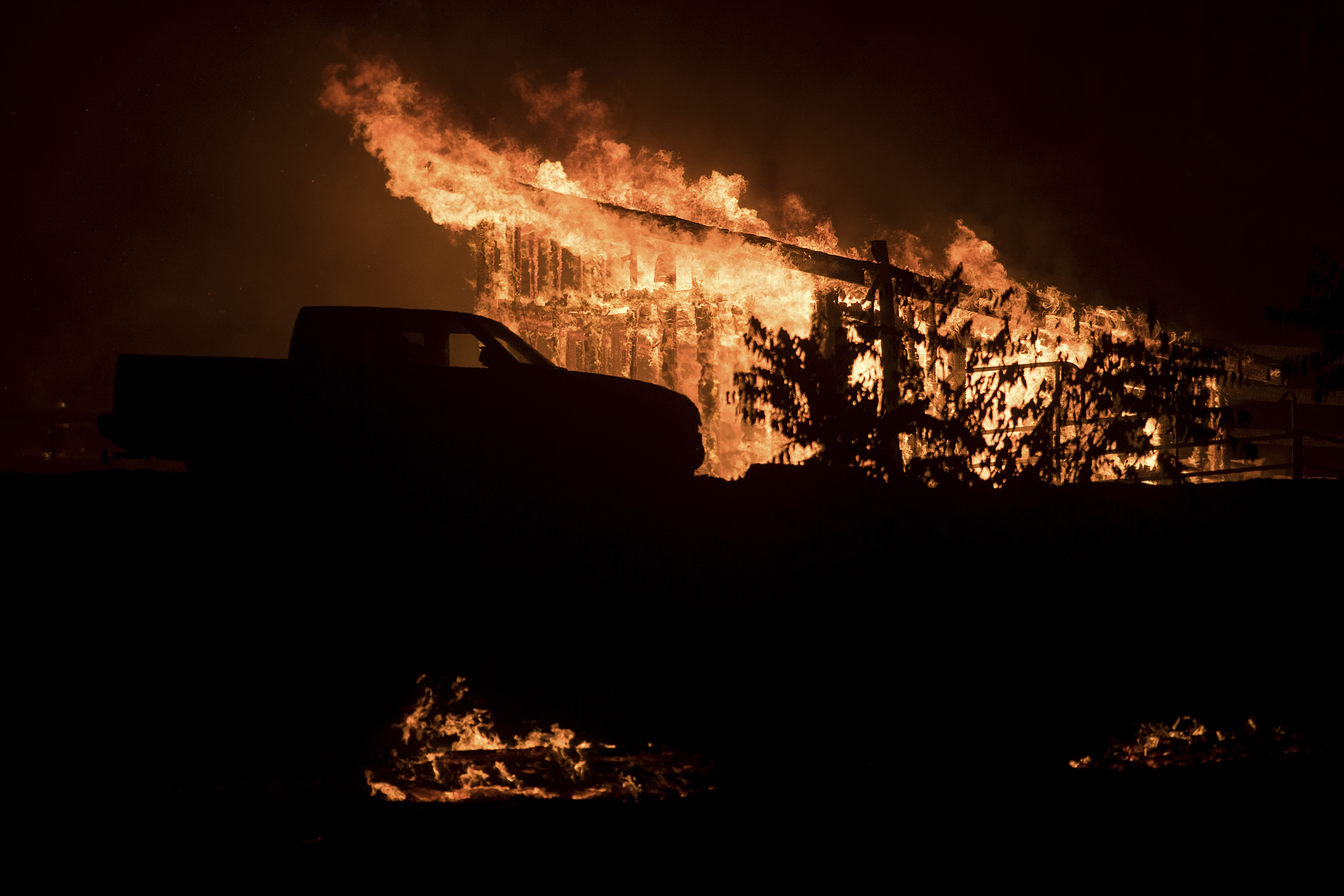 <div class='meta'><div class='origin-logo' data-origin='none'></div><span class='caption-text' data-credit='Noah Berger/AP Photo'>Flames consume a structure as a wildfire burns in Casitas Springs, Calif., on Tuesday, Dec. 5, 2017.</span></div>