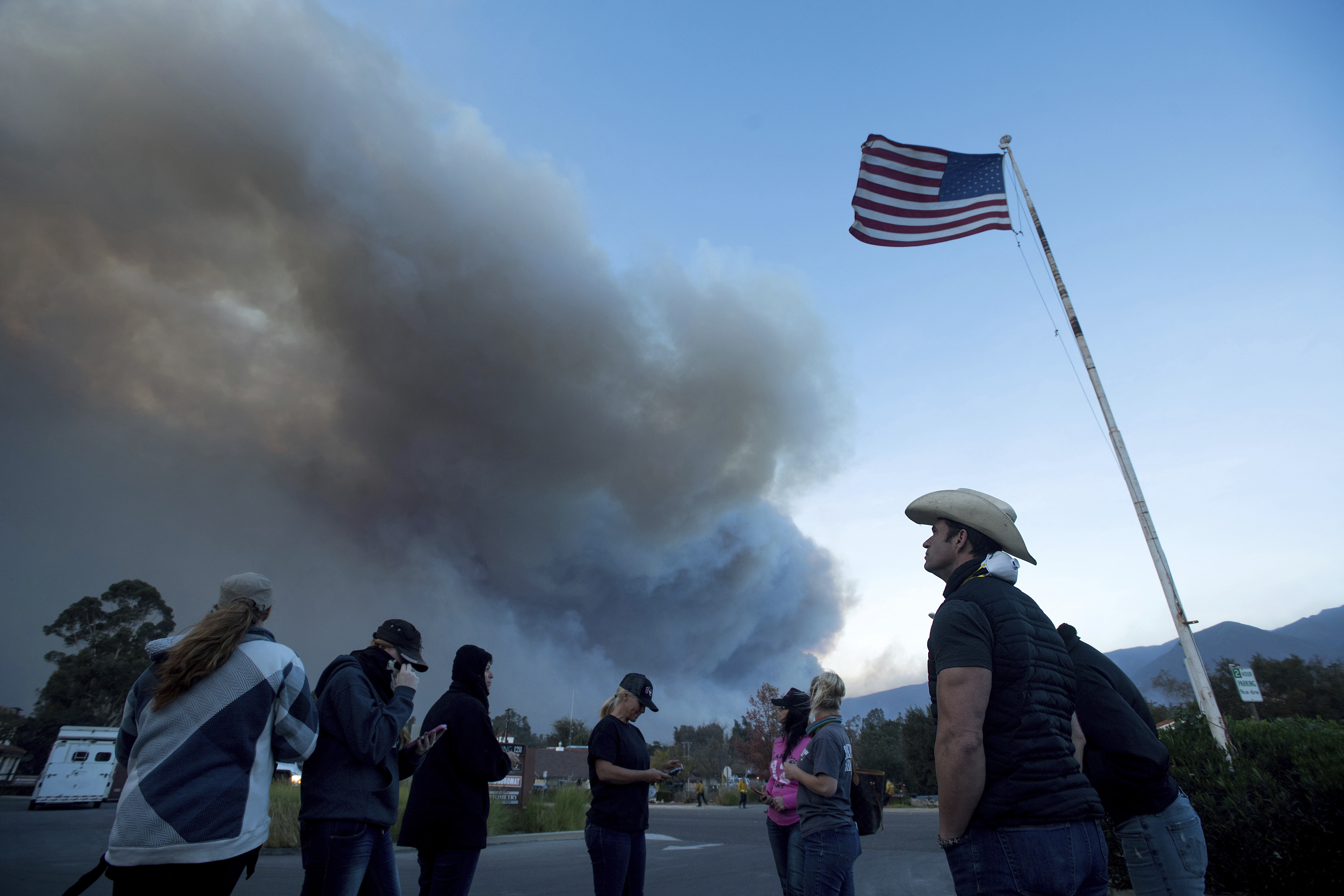 <div class='meta'><div class='origin-logo' data-origin='none'></div><span class='caption-text' data-credit='Noah Berger/AP Photo'>A group of horse rescuers who met on Facebook gather in a parking lot in Ojai, Calif., on Dec. 7. They estimate they've saved 100 horses.</span></div>