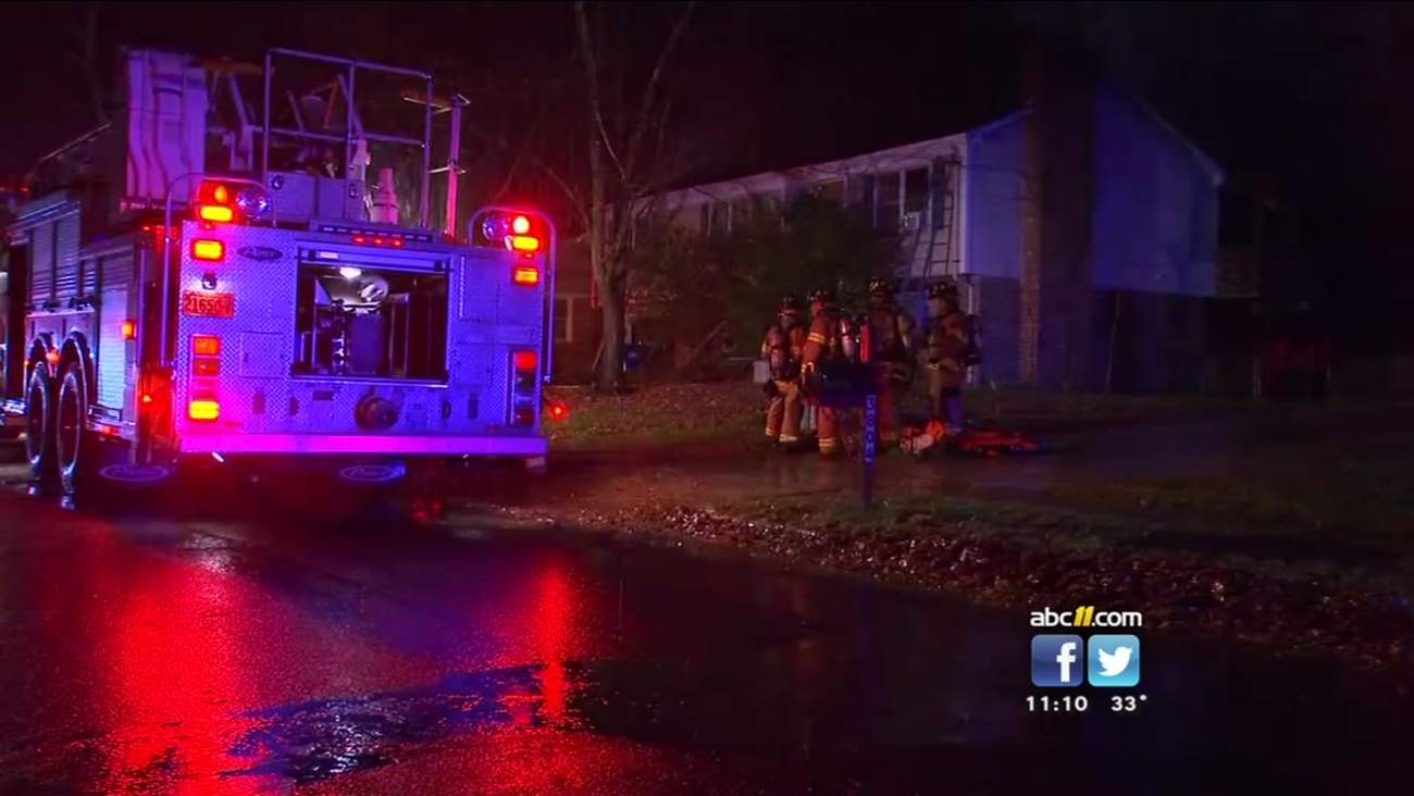 Woman pulled from burning home