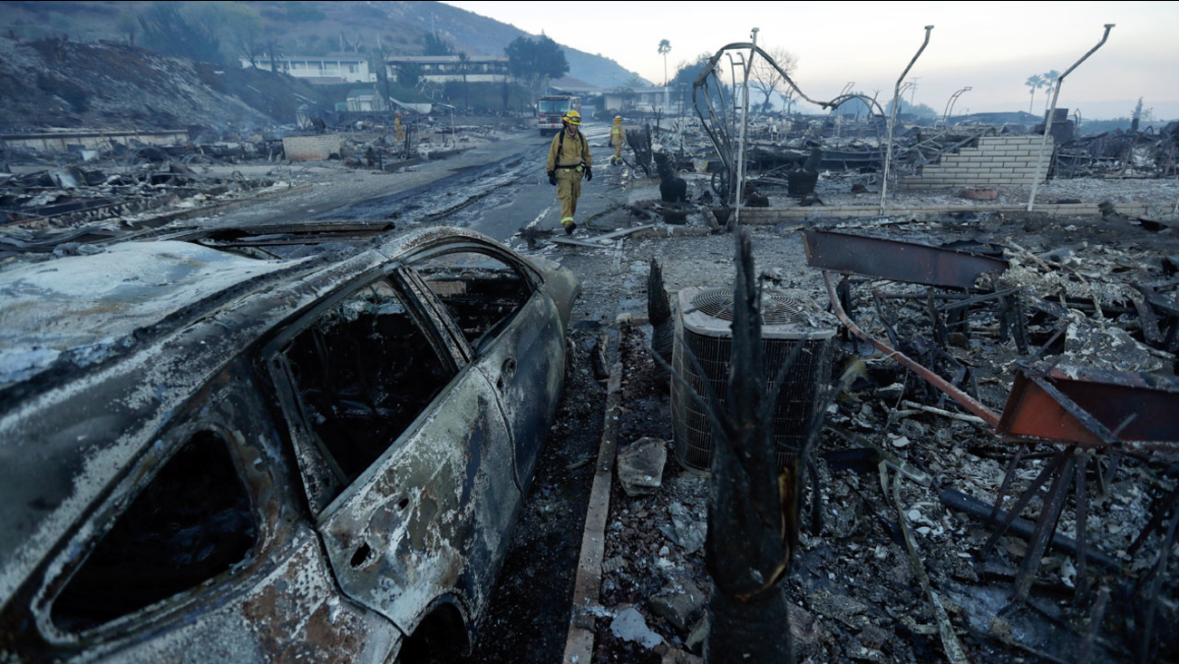 Fire crews search for hot spots among destroyed homes in the Rancho Monserate Country Club community Friday, Dec. 8, 2017, in Fallbrook, Calif.