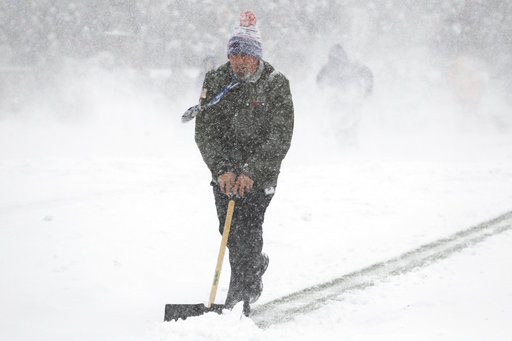 "<div class=""meta image-caption""><div class=""origin-logo origin-image ap""><span>AP</span></div><span class=""caption-text"">A man tries to clear snow off the field during the first half of an NFL football game between the Buffalo Bills and the Indianapolis Colts, Sunday, Dec. 10, 2017. (AP Photo/Jeffrey T. Barnes)</span></div>"