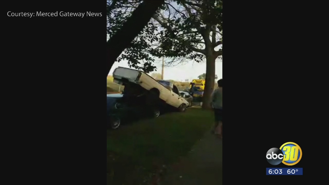 Accident sends truck flying through air, lands on cars in