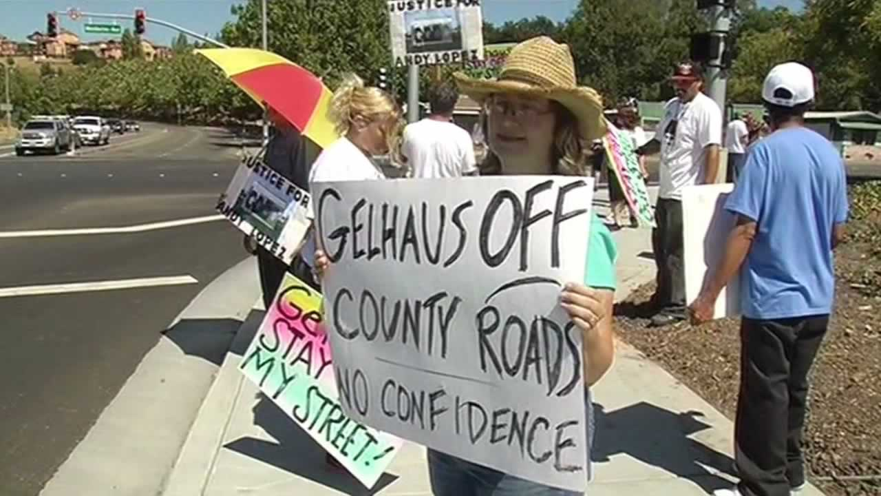 Activists protesting the return of Deputy Erick Gelhaus