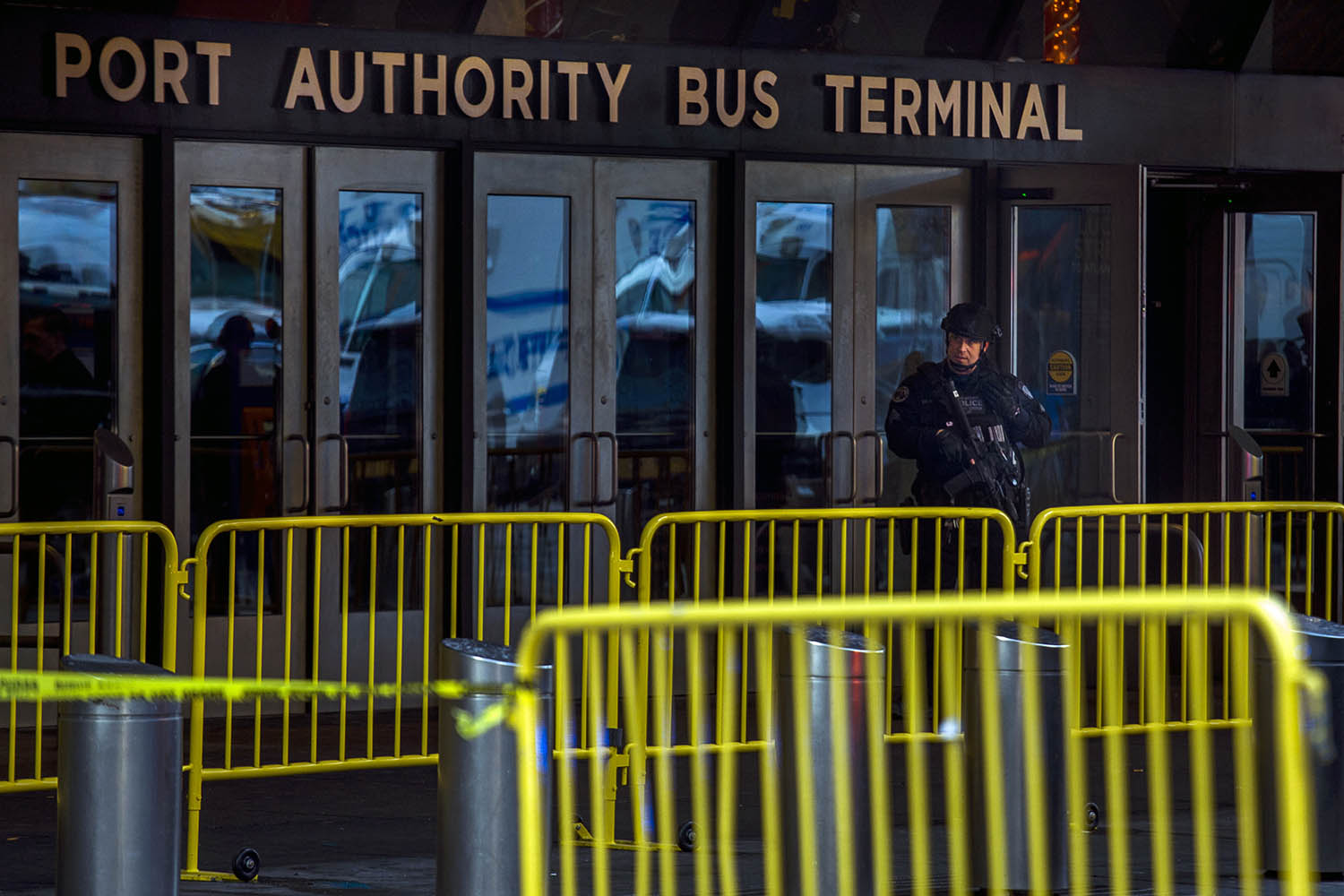 "<div class=""meta image-caption""><div class=""origin-logo origin-image ap""><span>AP</span></div><span class=""caption-text"">A police officer stands guard in front of Port Authority Bus Terminal as law enforcement respond to a report of an explosion near Times Square on Monday, Dec 11, 2017, in New York. (AP Photo/Andres Kudacki)</span></div>"