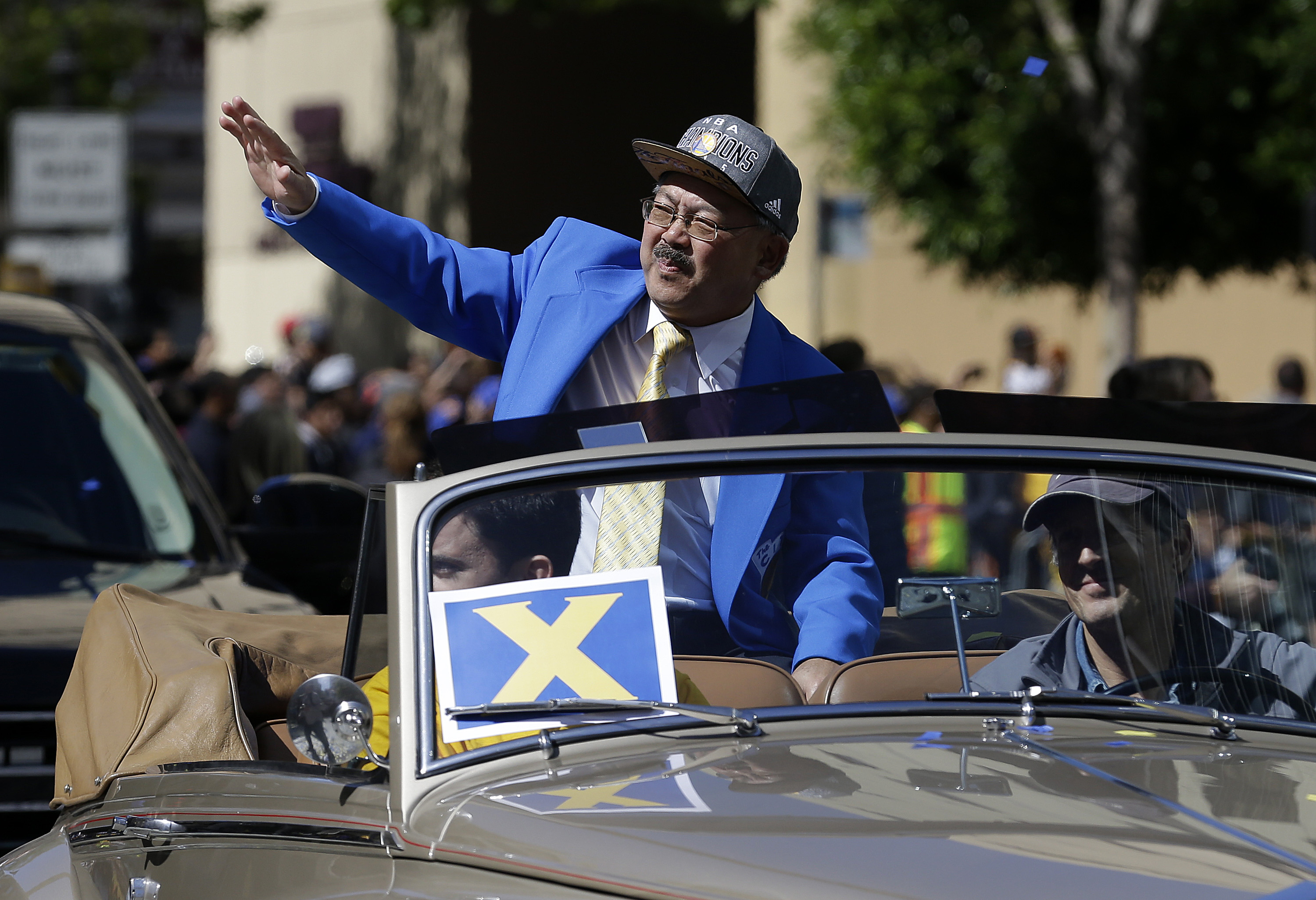 <div class='meta'><div class='origin-logo' data-origin='none'></div><span class='caption-text' data-credit='Jeff Chiu/AP Photo'>San Francisco Mayor Ed Lee waves during a parade for the Golden State Warriors winning the NBA championship in Oakland, Calif., Friday, June 19, 2015.</span></div>
