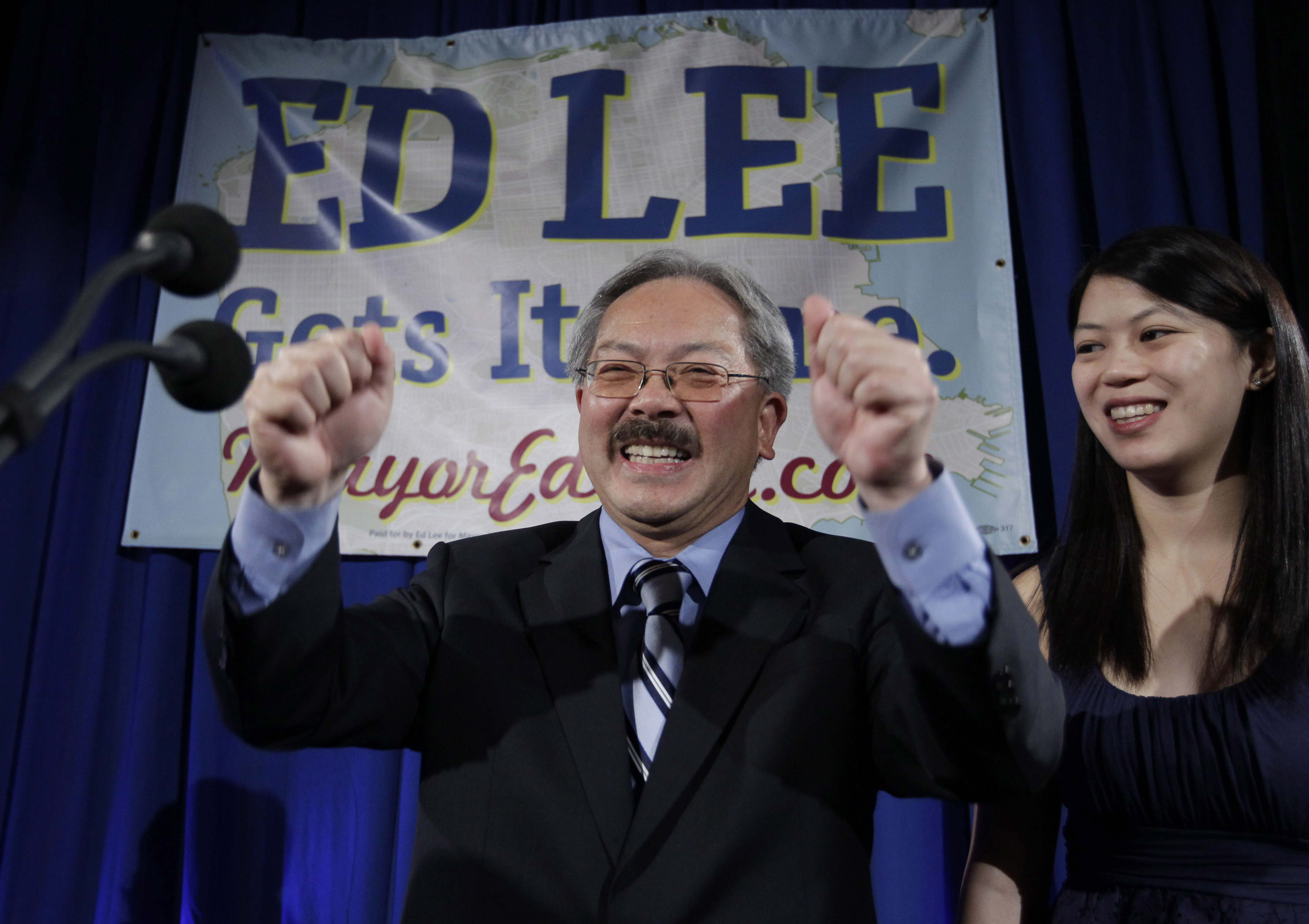 <div class='meta'><div class='origin-logo' data-origin='none'></div><span class='caption-text' data-credit='Paul Sakuma/AP Photo'>San Francisco interim mayor Ed Lee smiles as his daughter, Brianna, right, looks on at his campaign headquarters for mayor in San Francisco, Tuesday, Nov. 8, 2011.</span></div>