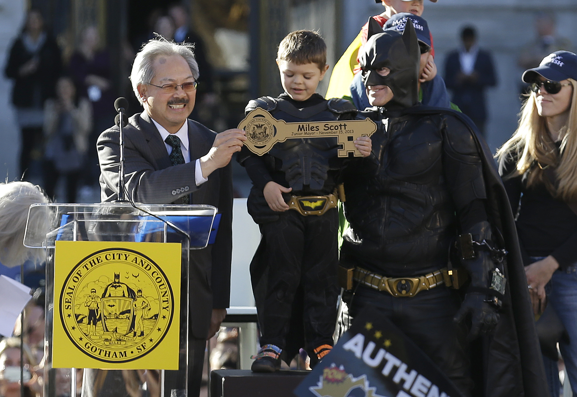 <div class='meta'><div class='origin-logo' data-origin='none'></div><span class='caption-text' data-credit='Jeff Chiu/AP Photo'>''Batkid',' 5-year-old leukemia patient Miles Scott, stands next to Batman as he receives the key to the city from Mayor Ed Lee, at a rally outside of City Hall Nov. 15, 2013.</span></div>