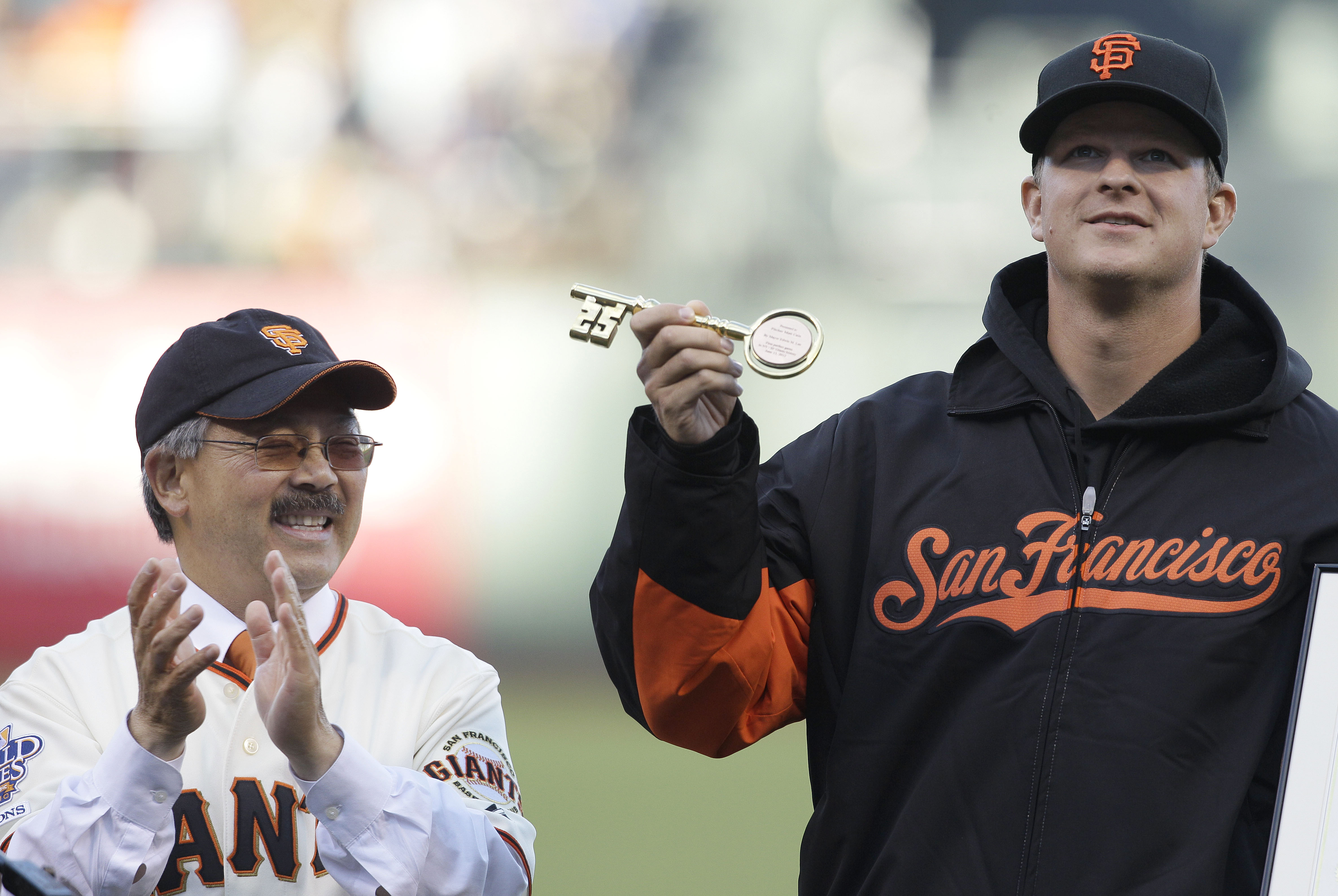 <div class='meta'><div class='origin-logo' data-origin='none'></div><span class='caption-text' data-credit='Jeff Chiu/AP Photo'>Mayor Ed Lee applauds after presenting a key to the city to Giants pitcher Matt Cain in honor of Cain's perfect game against the Houston Astros, during a ceremony, June 26, 2012.</span></div>