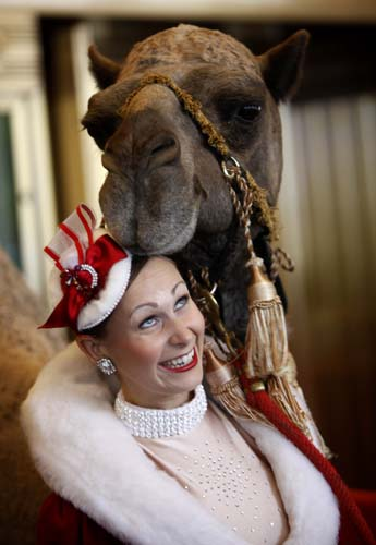 "<div class=""meta image-caption""><div class=""origin-logo origin-image none""><span>none</span></div><span class=""caption-text"">Rockette Candace Jablonski looks up as a camel named Sally touches her head at Radio City Music Hall in New York. (AP Photo/Seth Wenig)</span></div>"