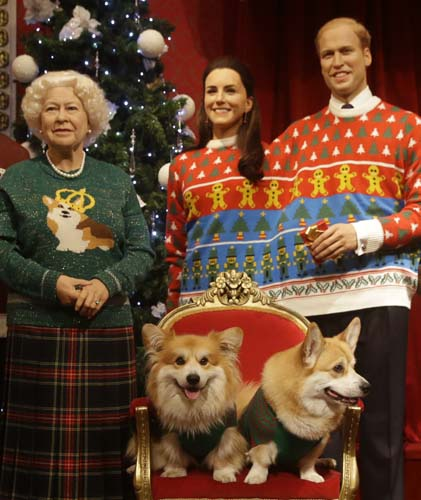 "<div class=""meta image-caption""><div class=""origin-logo origin-image none""><span>none</span></div><span class=""caption-text"">Two Welsh Pembrokeshire Corgi dogs sit on a chair in front of wax work models of the British Royal family at Madame Tussauds wax works in London. (AP Photo/Alastair Grant)</span></div>"