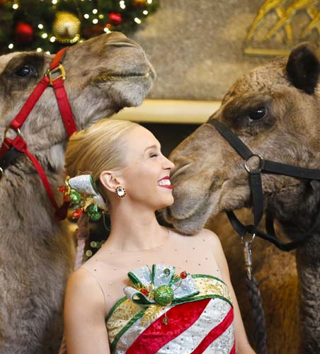 "<div class=""meta image-caption""><div class=""origin-logo origin-image none""><span>none</span></div><span class=""caption-text"">Radio City Rockette star Lauren Renck stands between camels during the blessing of animals at Radio City Music Hall in New York. (AP Photo/Bebeto Matthews)</span></div>"