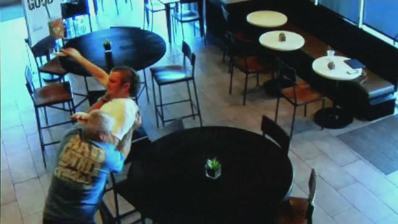 Ryan Flores is seen being taken down by a good Samaritan while attempting to rob a Starbucks store in Fresno, Calif.