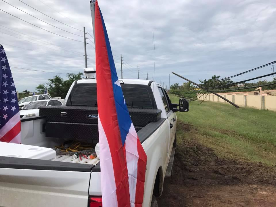 "<div class=""meta image-caption""><div class=""origin-logo origin-image none""><span>none</span></div><span class=""caption-text"">These contractors from Idaho and Texas are flying the Puerto Rican flag on every truck.</span></div>"
