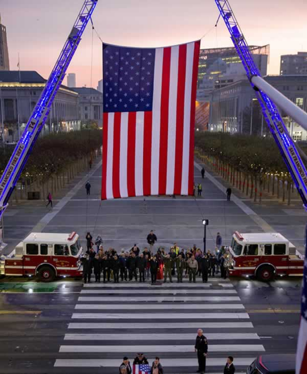 <div class='meta'><div class='origin-logo' data-origin='none'></div><span class='caption-text' data-credit='Santiago Mejia / The San Francisco Chronicle'>City officials stand beneath an American Flag honoring the late San Francisco Mayor Ed Lee at City Hall on Friday, Dec. 15, 2017.</span></div>