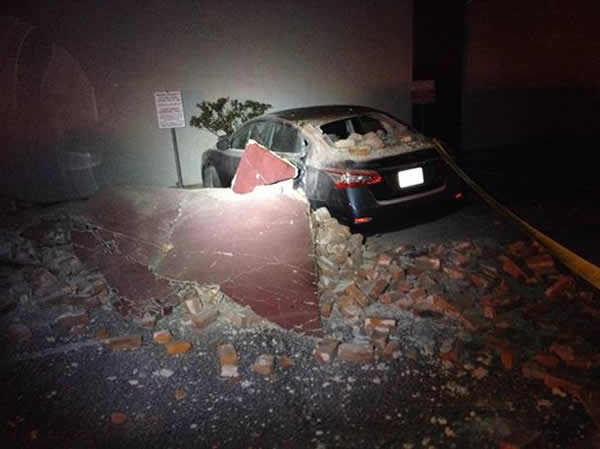 "<div class=""meta image-caption""><div class=""origin-logo origin-image ""><span></span></div><span class=""caption-text"">Bricks and fallen rubble cover a car after a 6.0-magnitude earthquake struck the northern San Francisco Bay Area Sunday, Aug. 24, 2014. (www.twitter.com/adreannababyyy)</span></div>"