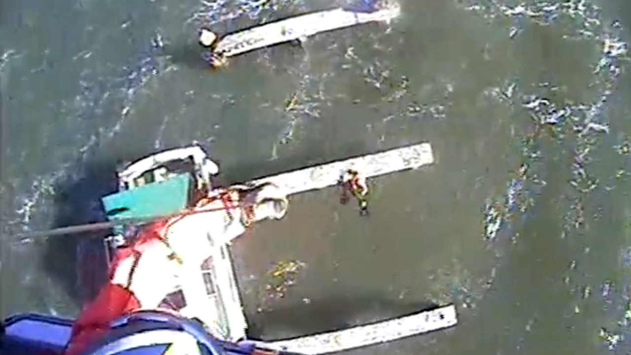 A Coast Guard crew is seen rescuing a boater near Berkeley, Calif. on Saturday, December 16, 2017.