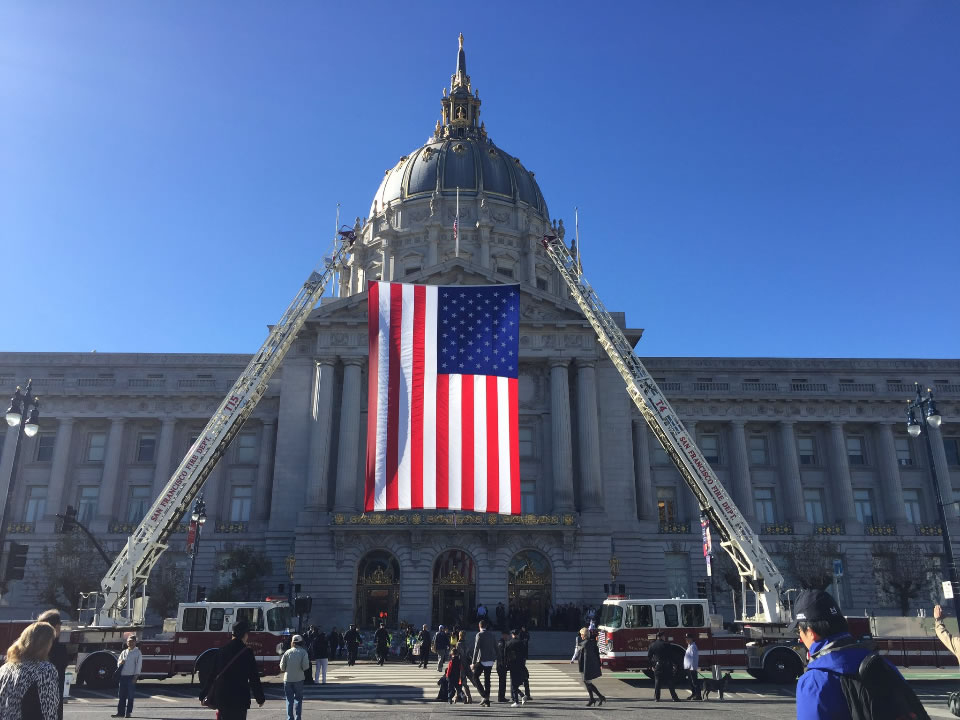 "<div class=""meta image-caption""><div class=""origin-logo origin-image none""><span>none</span></div><span class=""caption-text"">An American flag hanging from the ladders of fire trucks is seen ahead of San Francisco Mayor Ed Lee's memorial service on Sunday, Dec. 17, 2017. (Elissa Harrington/KGO-TV)</span></div>"