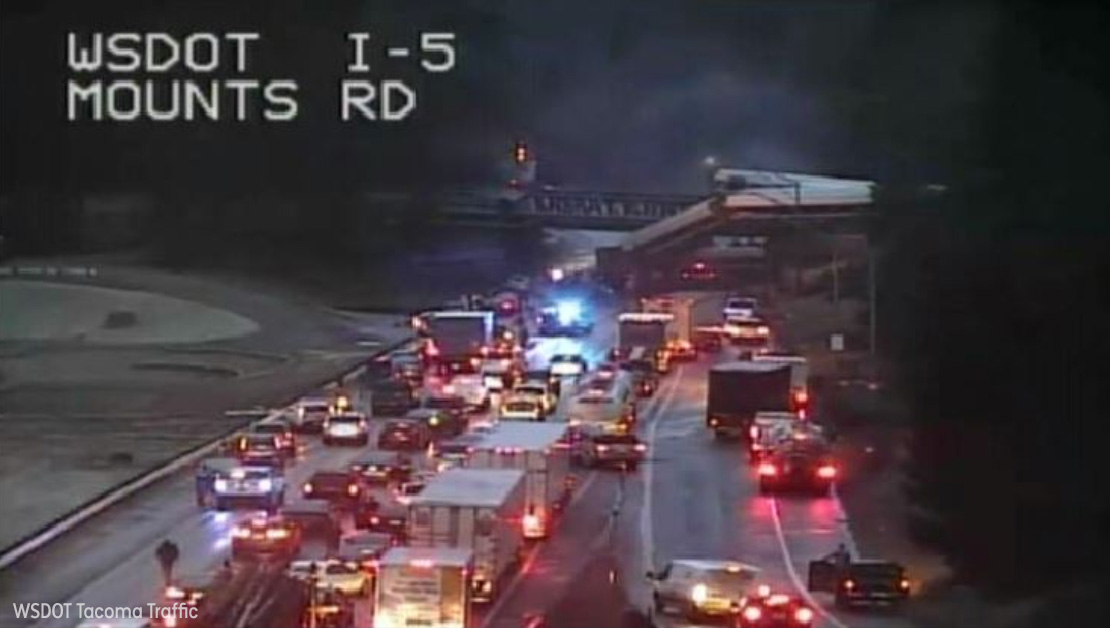 <div class='meta'><div class='origin-logo' data-origin='none'></div><span class='caption-text' data-credit='WSDOT Tacoma Traffic'>An Amtrak train traveling between Seattle and Portland derailed and fell off an overpass onto Interstate-5 south of Tacoma, Washington.</span></div>