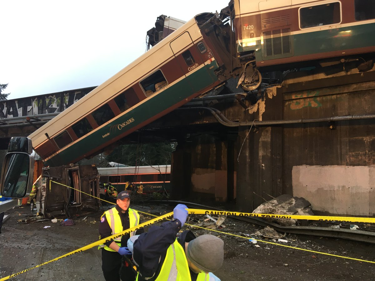 <div class='meta'><div class='origin-logo' data-origin='none'></div><span class='caption-text' data-credit='Pierce County Sheriff's Department/Twitter'>Photos from the Pierce County Sheriff's Department show the aftermath of a fatal train derailment near Tacoma.</span></div>