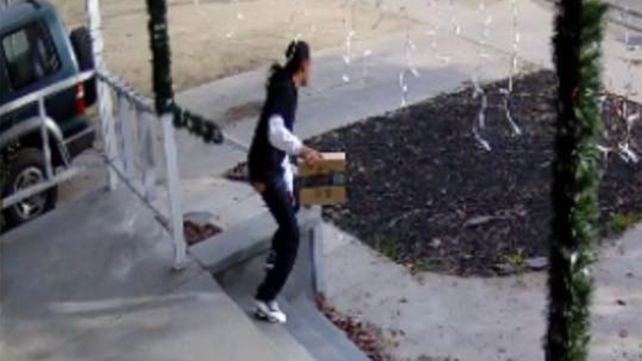 Camera catches a man taking a package from a Fresno County home.