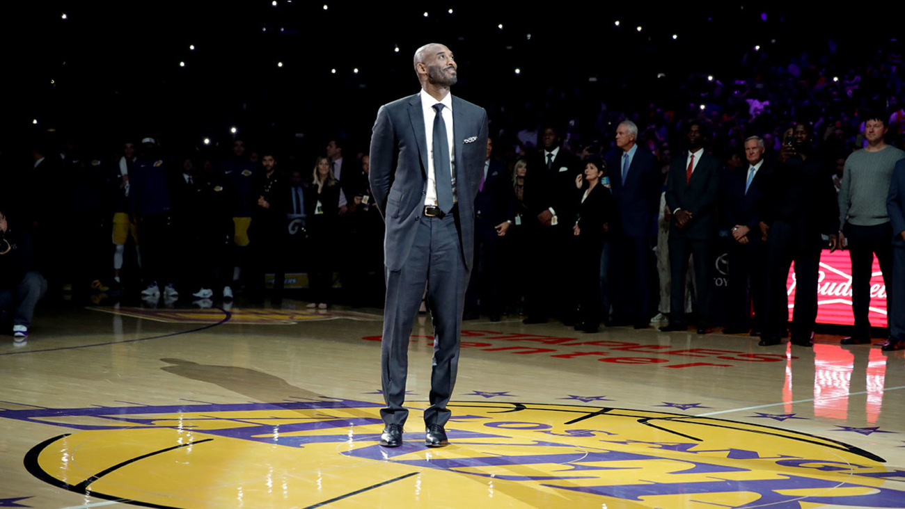 Former Los Angeles Laker Kobe Bryant arrives for a halftime ceremony, retiring both of his jersey's during an NBA basketball game in Los Angeles, Monday, Dec. 18, 2017.