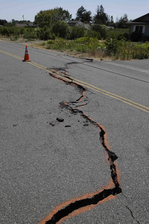 "<div class=""meta image-caption""><div class=""origin-logo origin-image ""><span></span></div><span class=""caption-text"">A cracked section of roadway is shown in the Carneros district following an earthquake Sunday, Aug. 24, 2014, in Napa, Calif. (AP Photo/Eric Risberg)</span></div>"