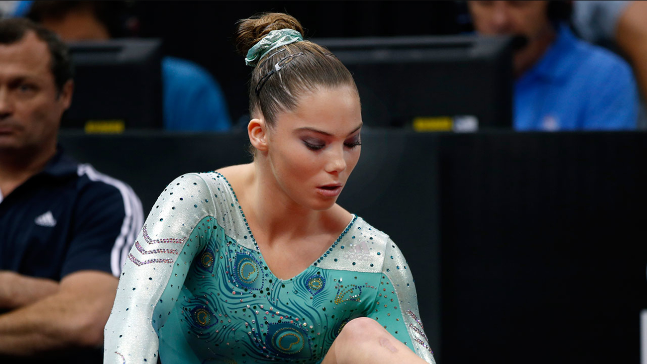 McKayla Maroney rubs her ankle prior to competition in the U.S. women's national gymnastics championships in Hartford, Conn. Thursday, Aug. 15, 2013.