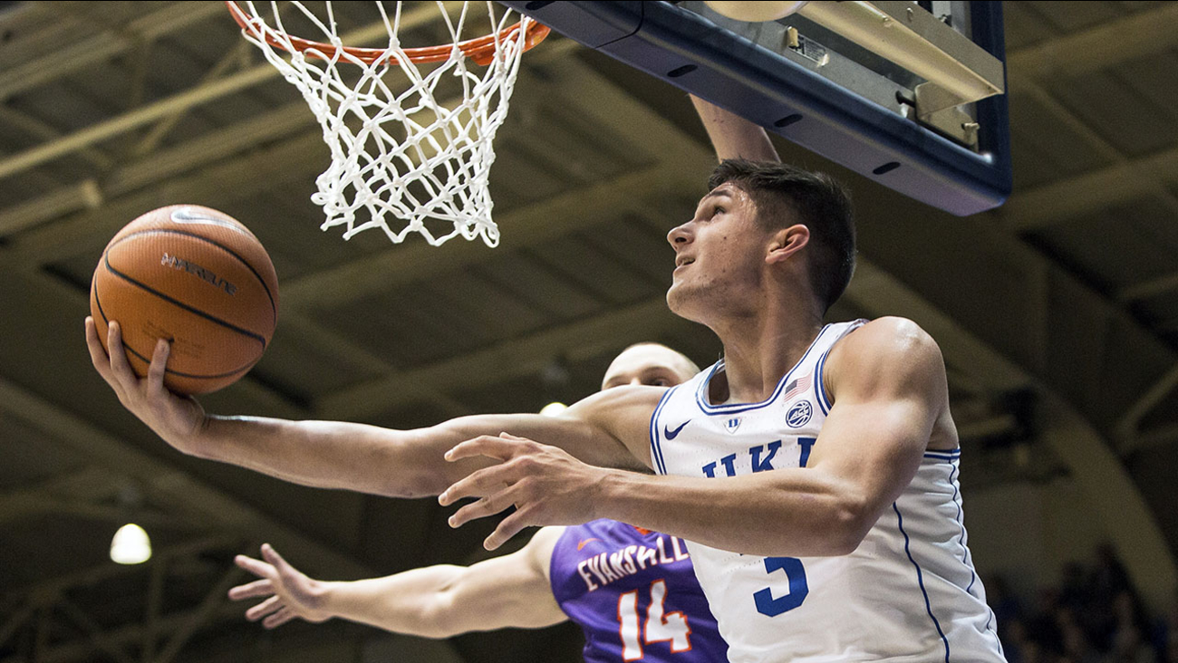 Duke's Grayson Allen slices in for a layup as Evansville's Dainius Chatkevicius defends Wednesday in Durham.