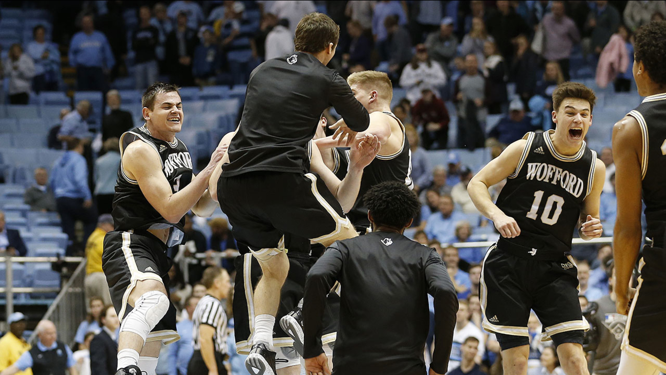 Wofford players celebrate their stunning win over the Tar Heels in Chapel Hill on Wednesday night.