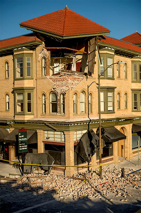 "<div class=""meta image-caption""><div class=""origin-logo origin-image ""><span></span></div><span class=""caption-text"">Bricks and debris surround the Alexandria Square building in Napa, CA. Officials in the city say 15 to 16 buildings are no longer inhabitable after the earthquake. (AP/Noah Berger)</span></div>"